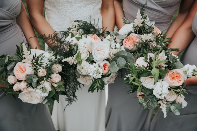 Bridal party bouquets with white and blush flowers
