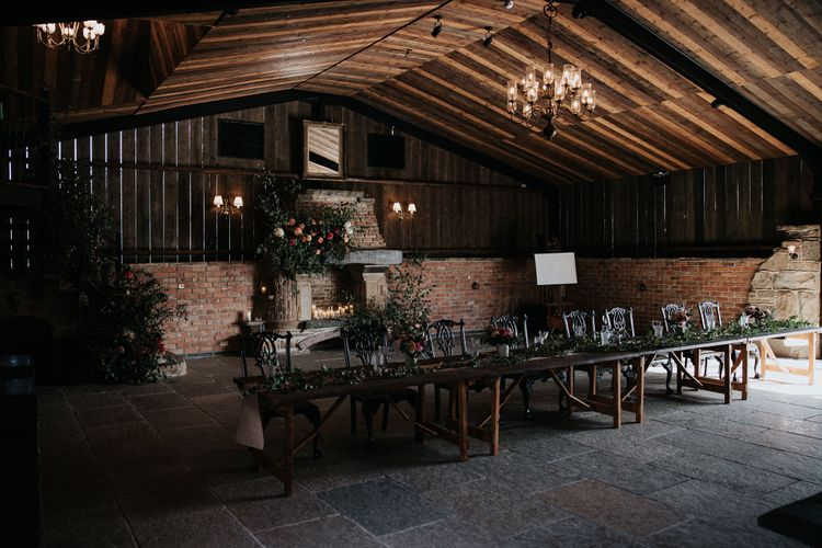 rustic barn wedding venue with floral arrangements at Willow Marsh Farm