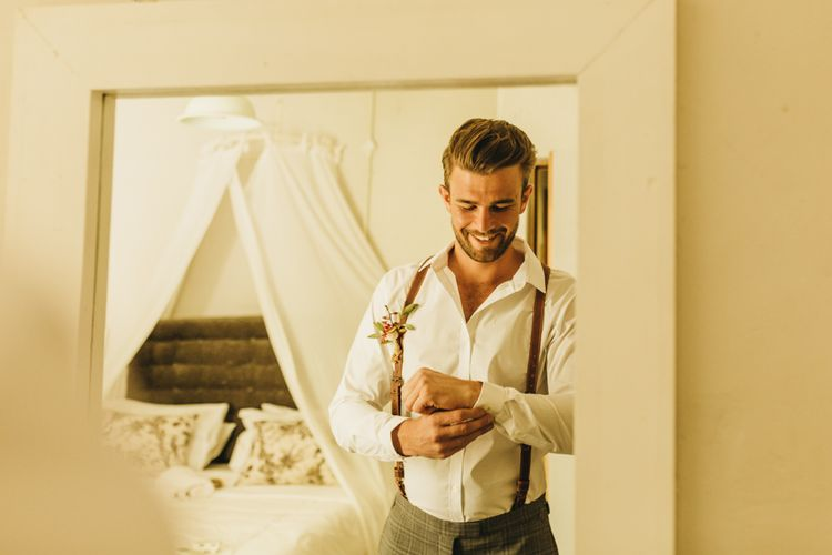 Groom preparations for destination wedding