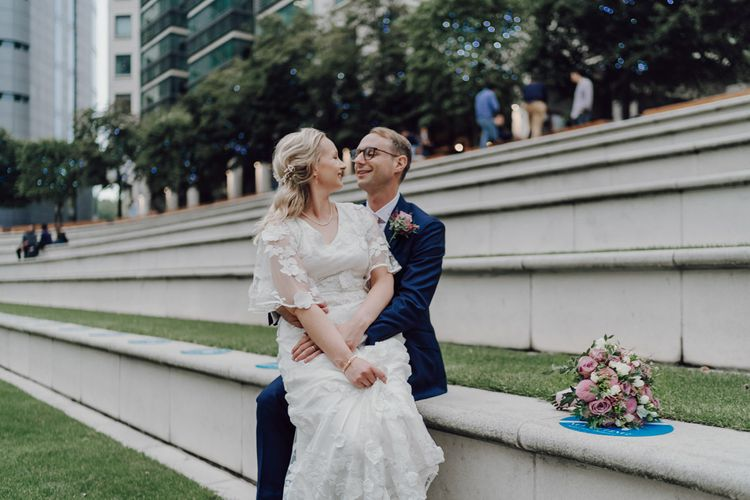 Bride and groom at London wedding with London wedding bus
