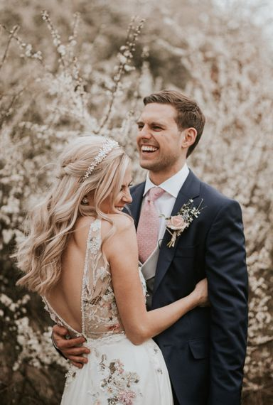 Bride in floral embroidered wedding dress and pearl headdress