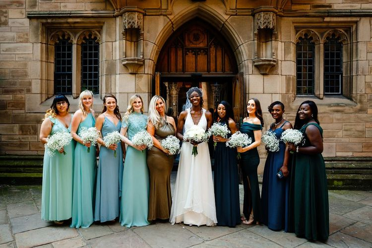 Bridal party portrait with bridesmaids in green ombre dresses