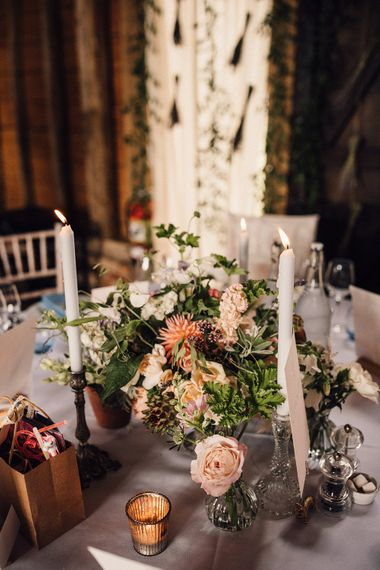 wildflower and candle table centrepiece at The Long Barn wedding reception