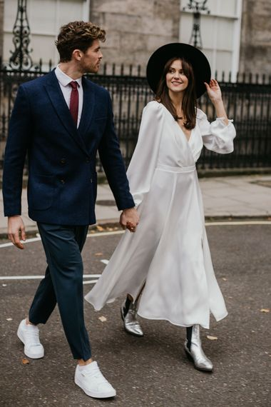Bride and groom crossing the road at London intimate wedding