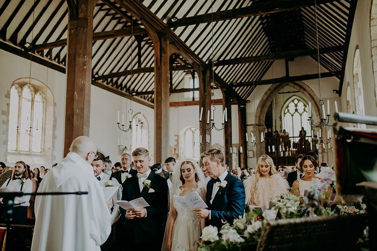 church wedding ceremony with congregation singing hymns