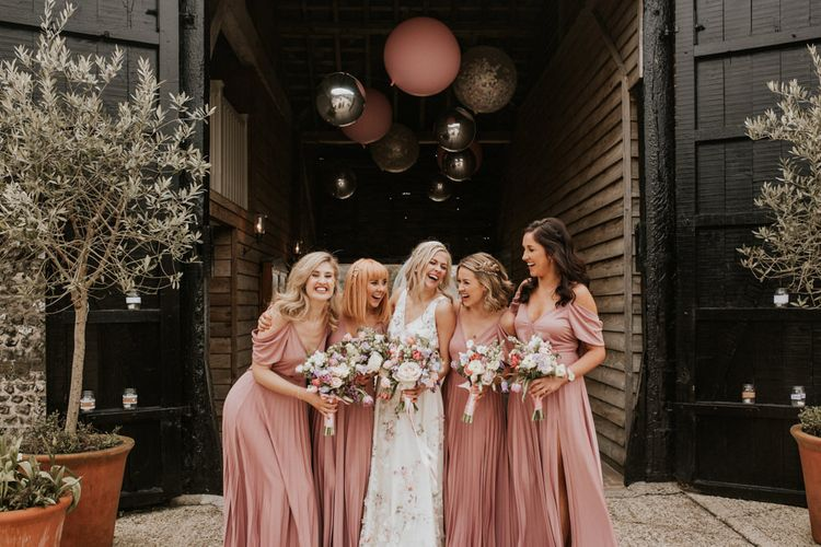 Bridal party outside Upwaltham Barns