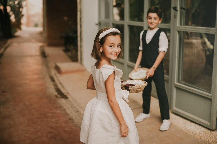 Flower girls and page boys with petal baskets