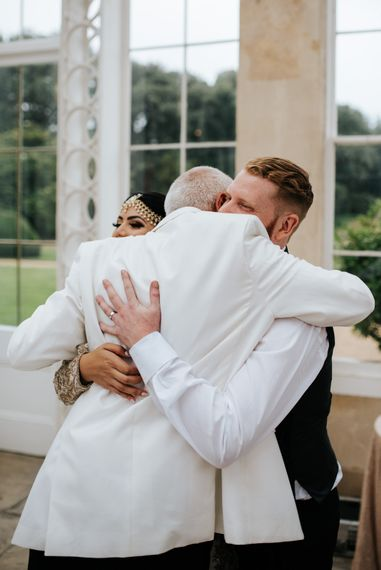 Groom embracing his new father in law
