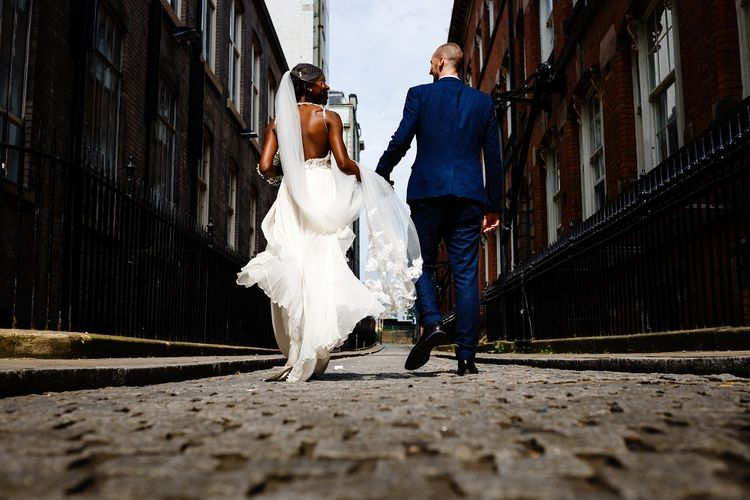 Urban bride and groom portrait by About Today Photography
