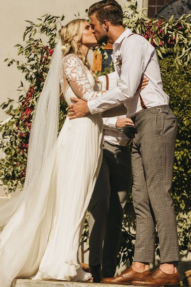 Bride and groom kiss at South Africa wedding ceremony