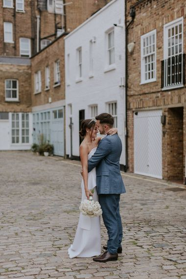 Bride and groom portrait in London streets by Maja Tsolo Photography