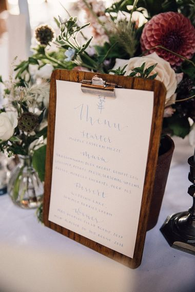 Blue and white wedding menus on clipboards