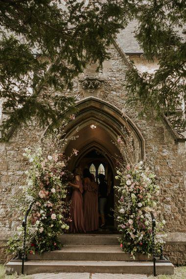 Church entrance floral arrangements