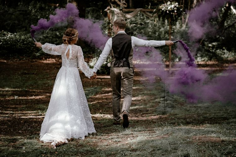 Purple smoke bombs at Sherwood Glade woodland wedding