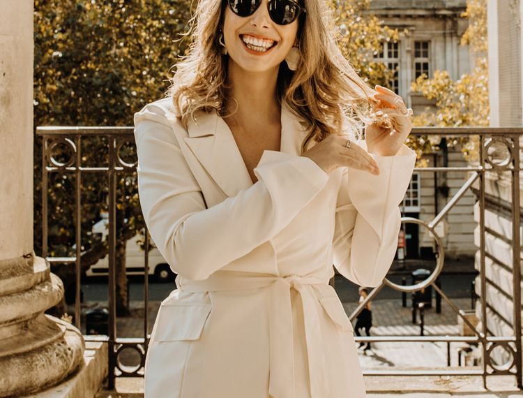 Stylish bride in ivory trouser suit from Topshop for city elopement