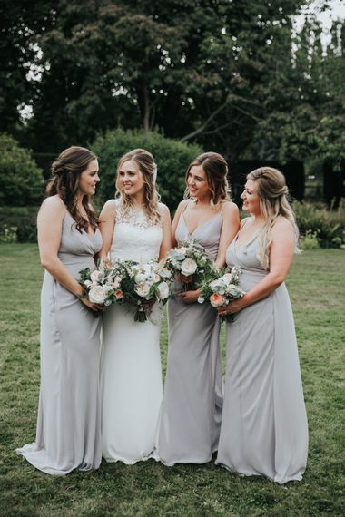 Bridal party portrait with bridesmaids in light grey dresses