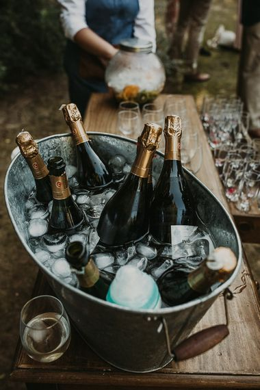 Champagne bottles in a trough