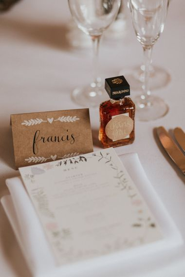 Miniature alcohol wedding favour at place setting