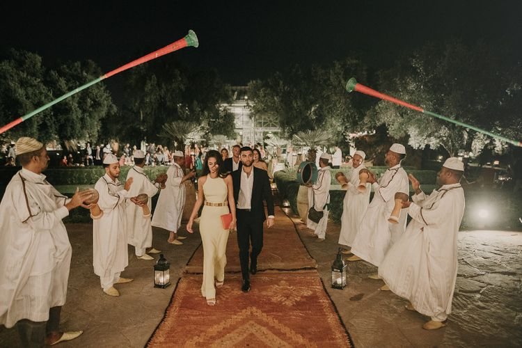Wedding guests arriving at Marrakech reception with Moroccan rugs