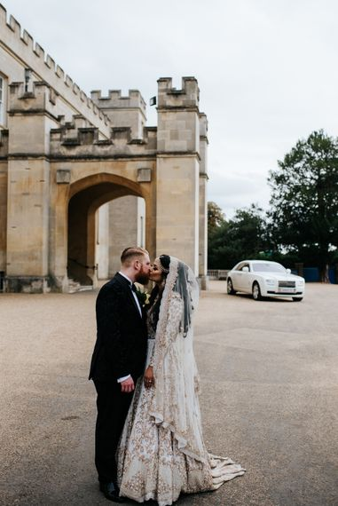 Bride and groom kissing at luxury wedding