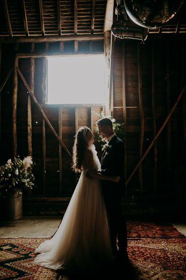 Bride and groom portrait in a barn by Irene Yap Weddings