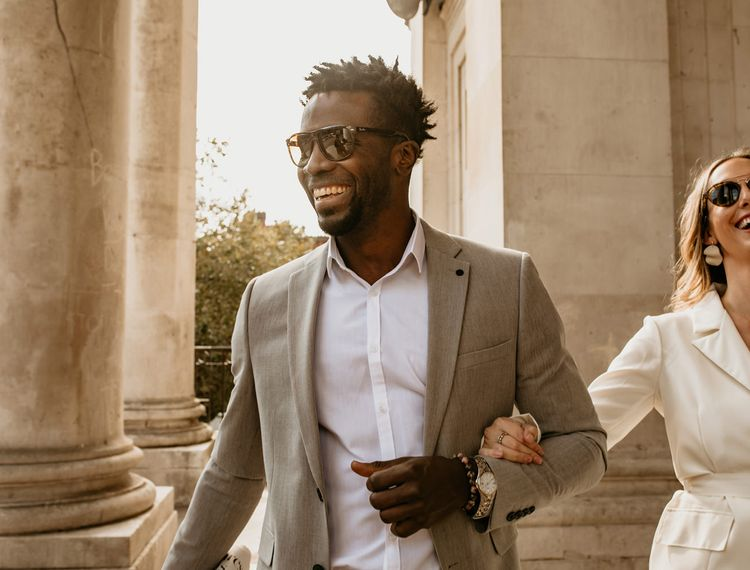 Groom in light grey suit, and white shirt for Portsmouth Guidhall elopement wedding