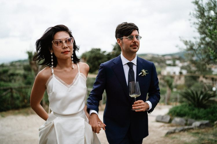 Stylish bride in Halfpenny London skirt and cami with shades and chandelier earrings