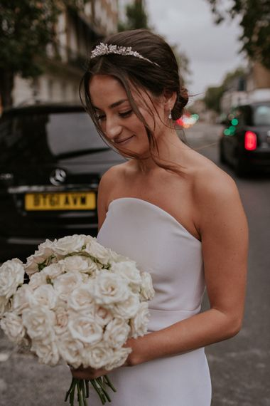 Stylish bride in Roland Mouret wedding dress with white bouquet