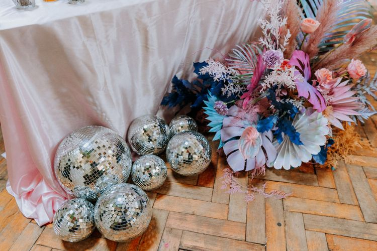 glitter balls and pastel flowers at festival wedding
