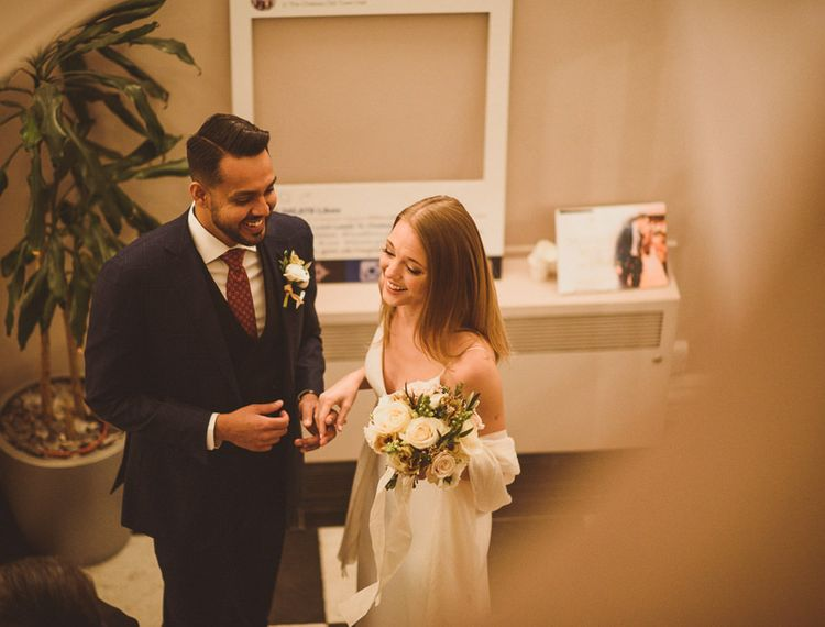Action shot of newly wed couple at London Wedding