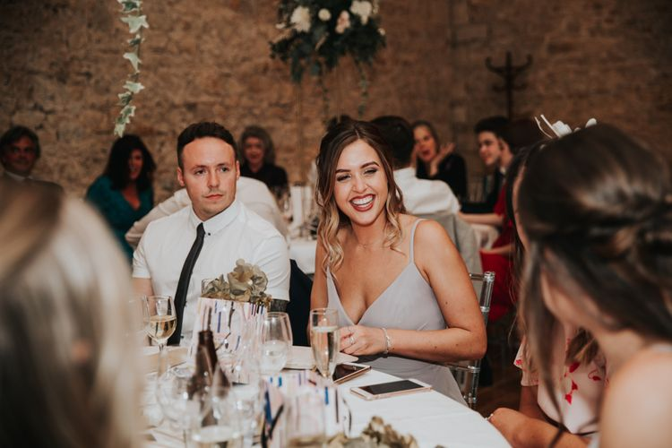 Wedding guest smiling at Notley Abbey reception
