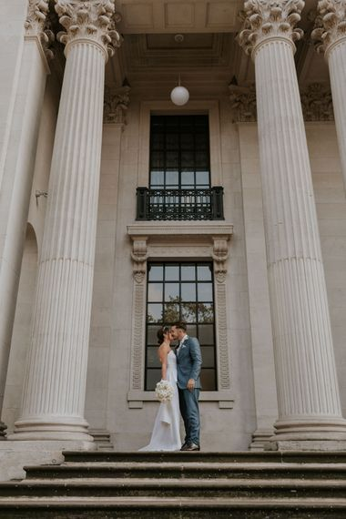 Bride and groom kissing at Old Marylebone Town Hall wedding