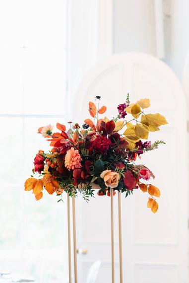 Tall autumn wedding flower arrangement
