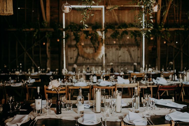 Table decor with bottles and candle centrepieces