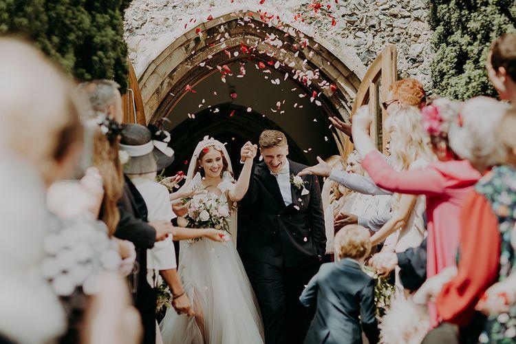 Church confetti exit by Irene Yap Weddings