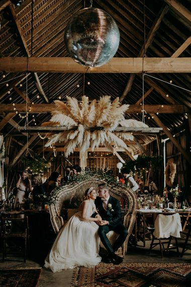 Barn reception with rustic wedding decor and dried flowers