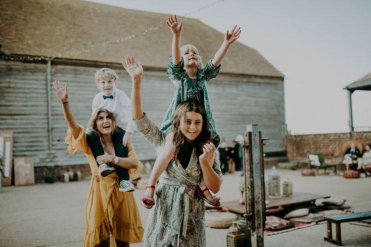 Wedding guests playing at barn wedding