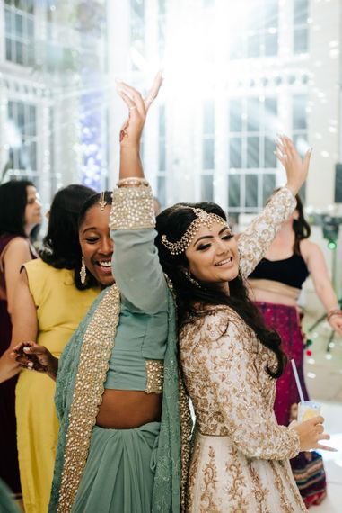 Bride and bridesmaid in Indian inspired dresses