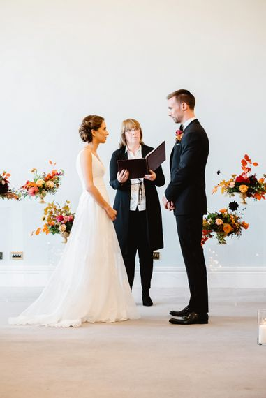 Bride and groom exchanging vows at Carlton House Terrace wedding planned by Always Andri Planner