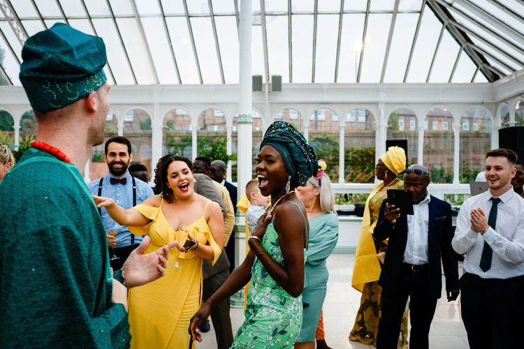 Bride and groom dancing at traditional Nigerian money dance