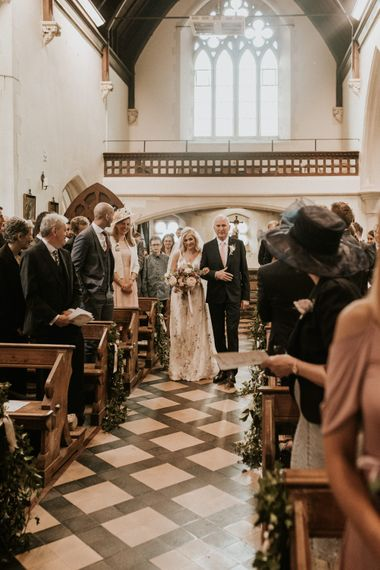 Church wedding ceremony bridal entrance in floral embroidered wedding dress
