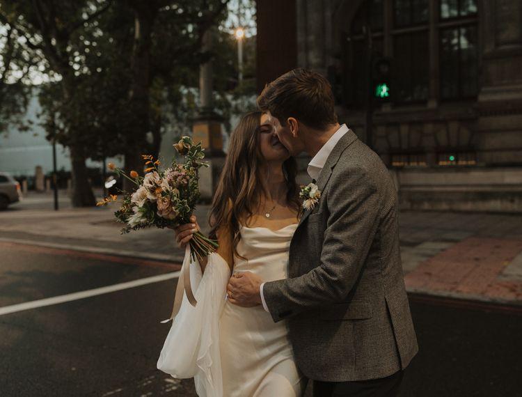 bride and groom at dusk wedding