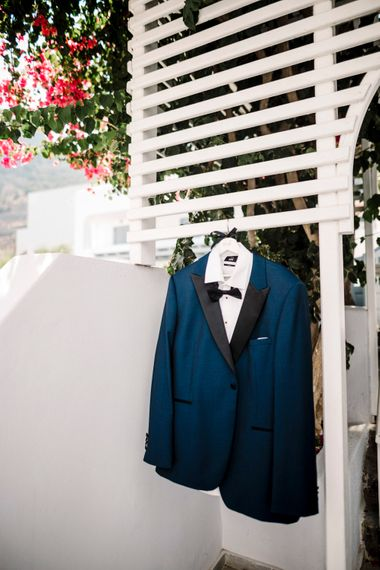 Teal tuxedo for groom at Santorini wedding