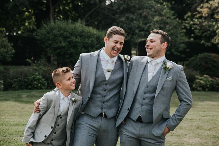 Groomsmen and page boy in grey suits