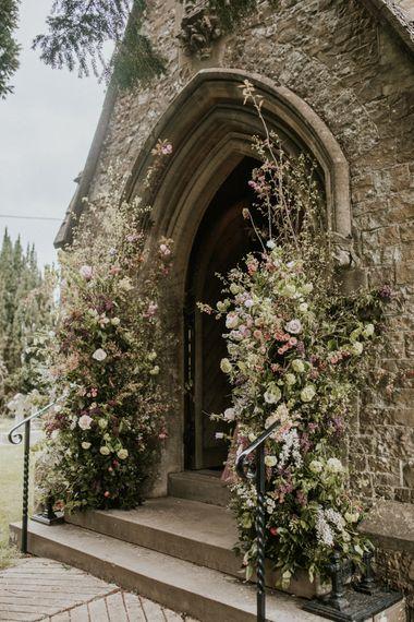 Wedding flowers decorating the church entrance