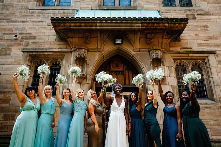 Bridesmaids in different green dresses