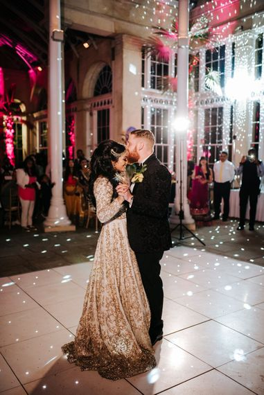 Bride and groom dancing at their Syon Park evening reception