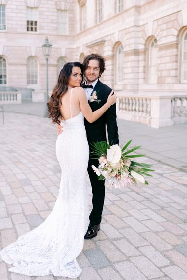 Bride and groom photography with King Protrea wedding bouquet