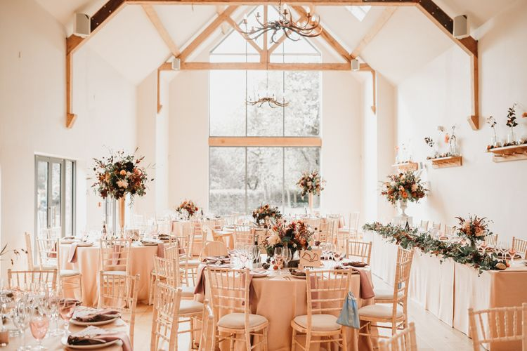 Millbridge Court wedding reception with autumn flowers and rustic decor