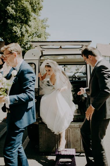 Bride arriving at the wedding in a jeep
